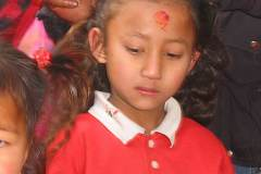 Erster Haarschnitt - Chudakarana - Haare werden mit Wasser benetzt