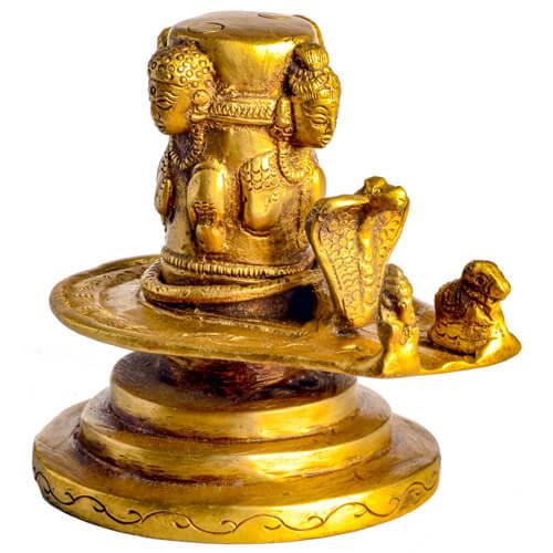 Shiva Lingam mit vier Köpfen aus Messing